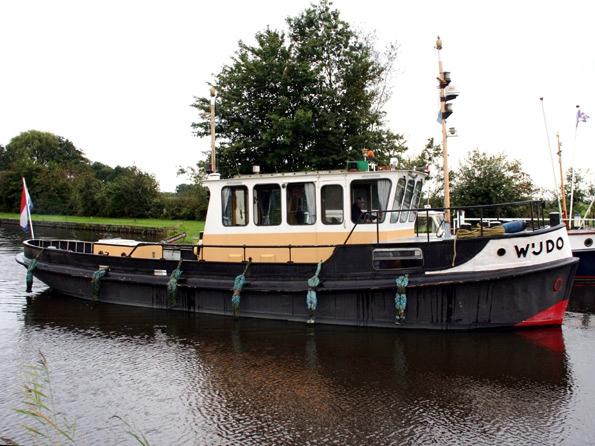 sleepboot (omgebouwd als jacht) te koop · Ligplaats: Sneek · WIJDO · ref 9010 · Scheepsmakelaardij Fikkers